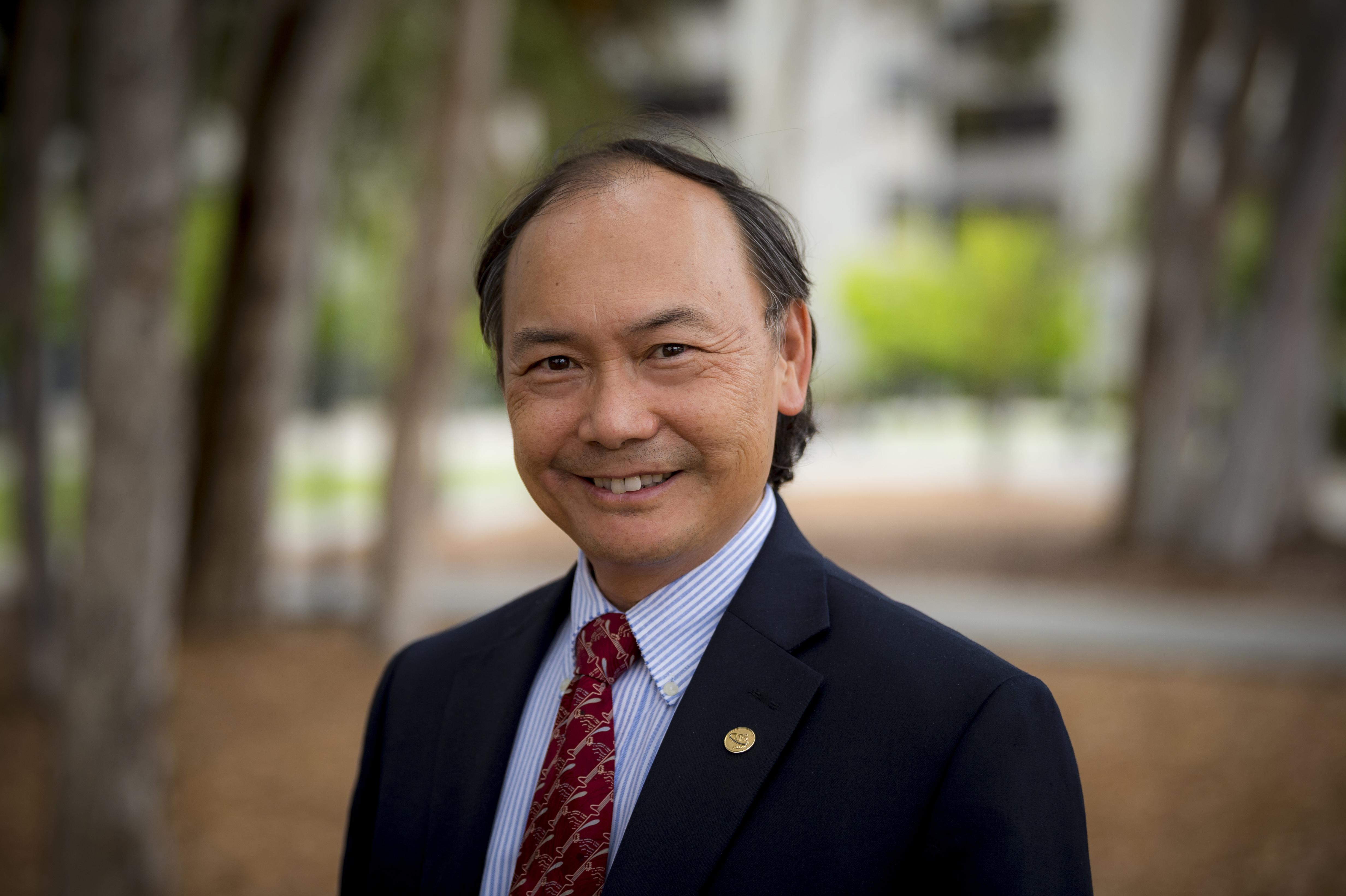 Dr. Charles Tu
