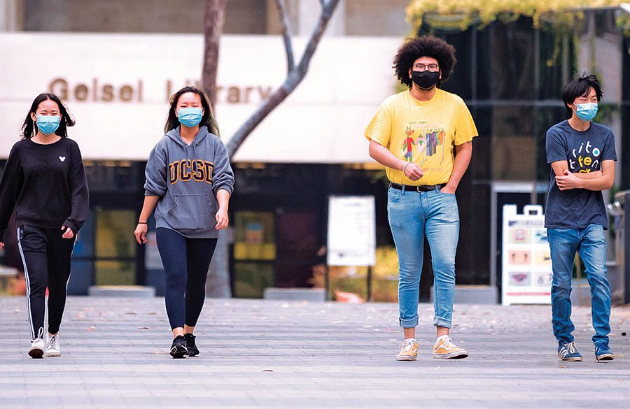 Masked Students walking from Geisel